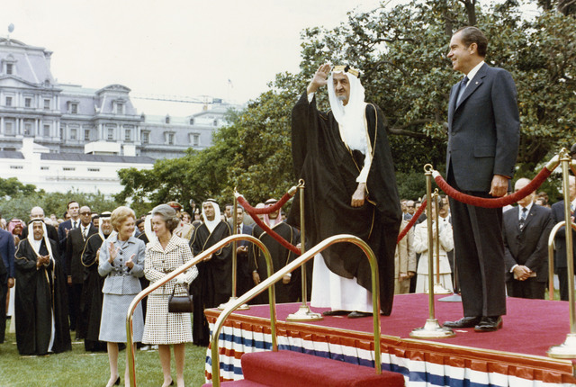 President Richard Nixon and King Faisal of Saudi Arabia during an Arrival Ceremony for King Faisal at the White House, Pat Nixon Stands near the Dias