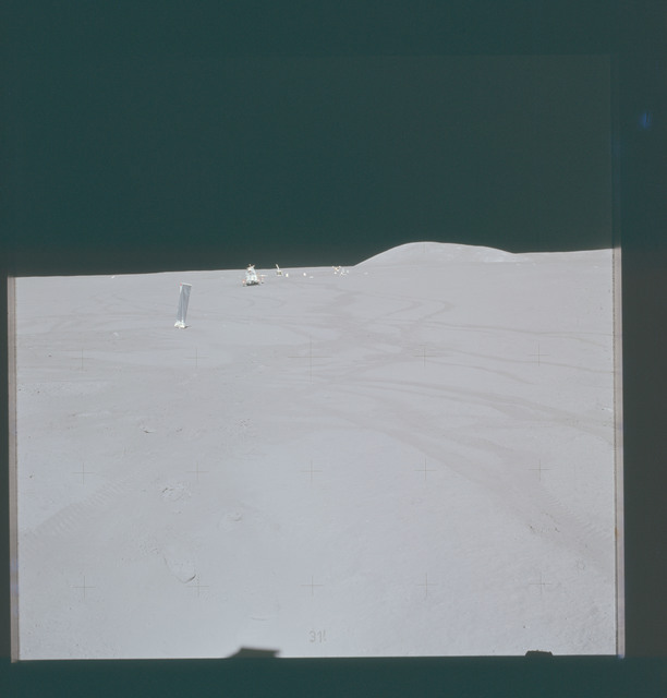 AS15-87-11805 - Apollo 15 - Apollo 15 Mission image - Panoramic north view of Lunar Module (LM) station SWC with LRV, ALSEP and Hill 305