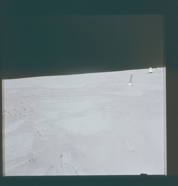 AS15-87-11821 - Apollo 15 - Apollo 15 Mission image - Panoramic north view of Lunar Module (LM) station with SWC, LRV and ALSEP