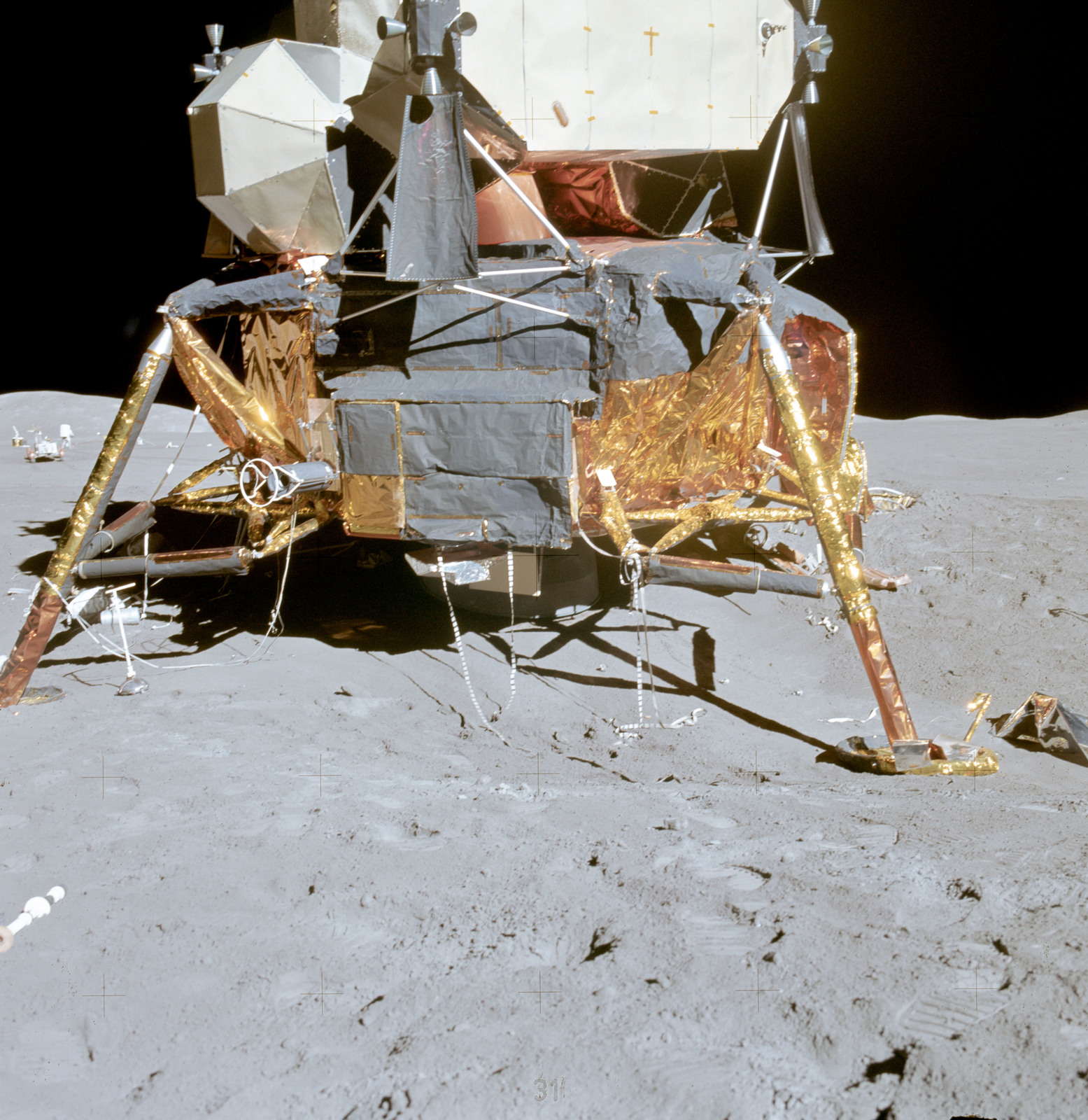 AS15-87-11839 - Apollo 15 - Apollo 15 Mission image - Panoramic southeast view of Lunar Module (LM), with LM in forground and ALSEP and Hill 305 in background