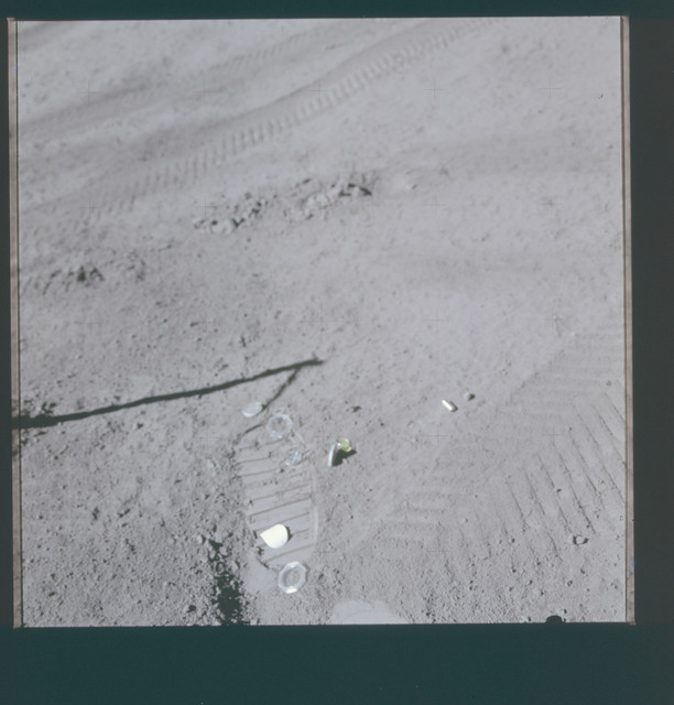 AS15-88-11867 - Apollo 15 - Apollo 15 Mission image - View of Station 8, Microfilm cassette and footprint