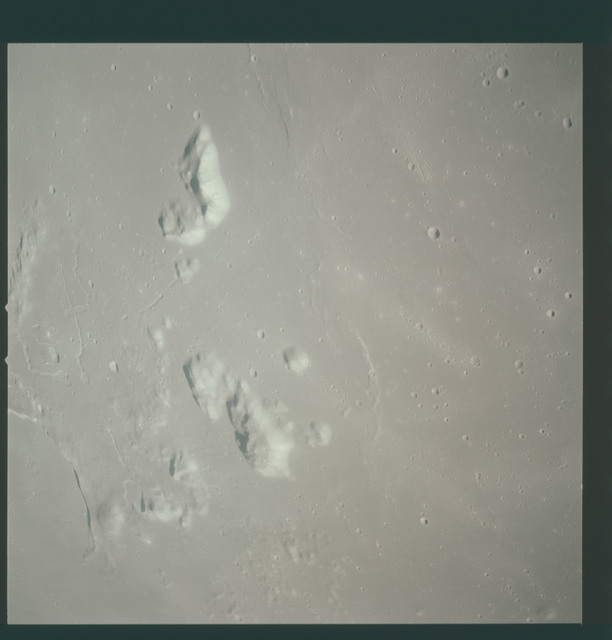 AS15-93-12595 - Apollo 15 - Apollo 15 Mission image - View of  Crater Prinz and Harbinger Mts