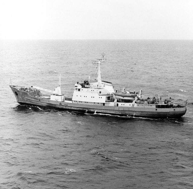 An aerial port beam view of a Soviet trawler, in the area during the launch of a UGM-73 Poseidon C-3 submarine-launched ballistic missile, from the nuclear-powered strategic missile submarine USS NATHANAEL GREEN (SSBN 636) (not shown)