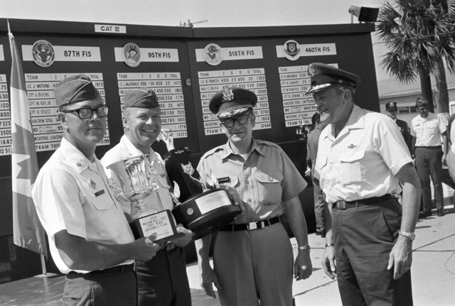 """U.S. Air Force Officer assigned to the 119th Fighter Wing""""Happy Hooligans"""", North Dakota Air National Guard, pose for a group photo after winning first place honors during the 1972 William Tell""""Weapons Competition at Tyndall, Air Force Base, Florida. Pictured left-to-right: MAJ. Alan Eide; LT. COL. Wally Hegg; MAJ. GEN. Ale LaClair A. Melhouse, North Dakota Adjutant General; and a unidentified U.S. Air Force MAJ. GEN. (A3604) (U.S. Air Force PHOTO) (Released)"""