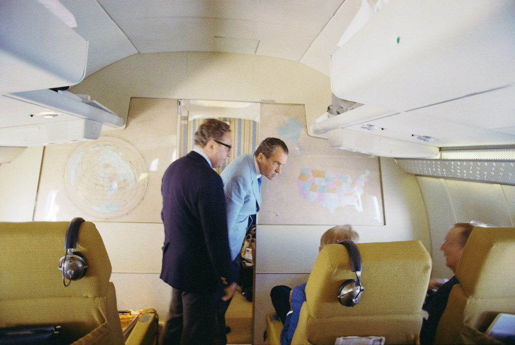 President Nixon Confers with His Foreign Policy Team onboard Air Force One en route to China