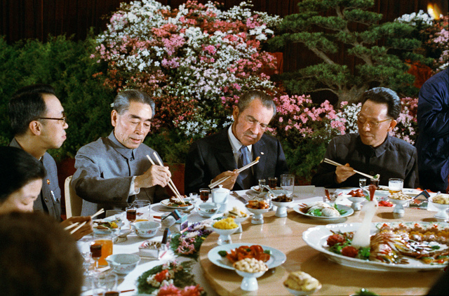 President Richard Nixon using Chopsticks during a Chinese Banquet with Premier Chou En-lai of the People's Republic of China