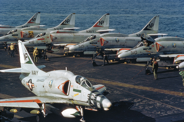 Attack Squadron 55 (VA-55) A-4F Skyhawk aircraft of Attack Carrier Wing 21 are parked on the flight deck of the attack aircraft carrier USS HANCOCK (CVA 19)