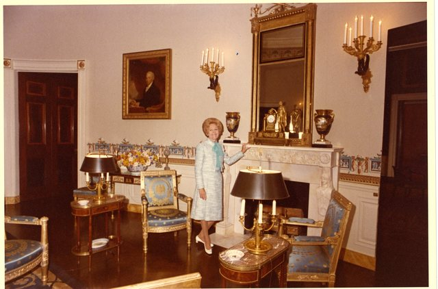 Pat Nixon Standing in the Blue Room, and receiving Flowers from Unidentified Men