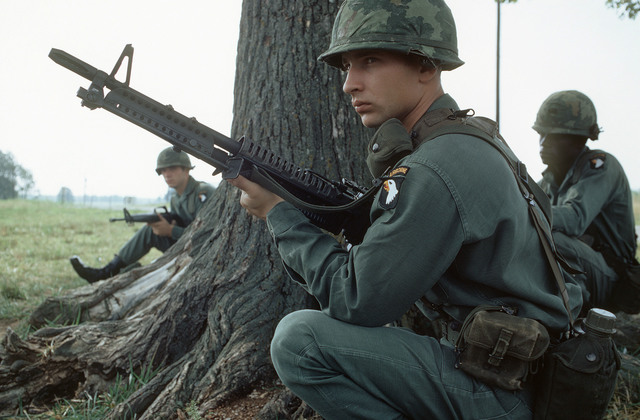 A member of the 101st Airborne Division, armed with an M60 machine gun, participates in a field exercise