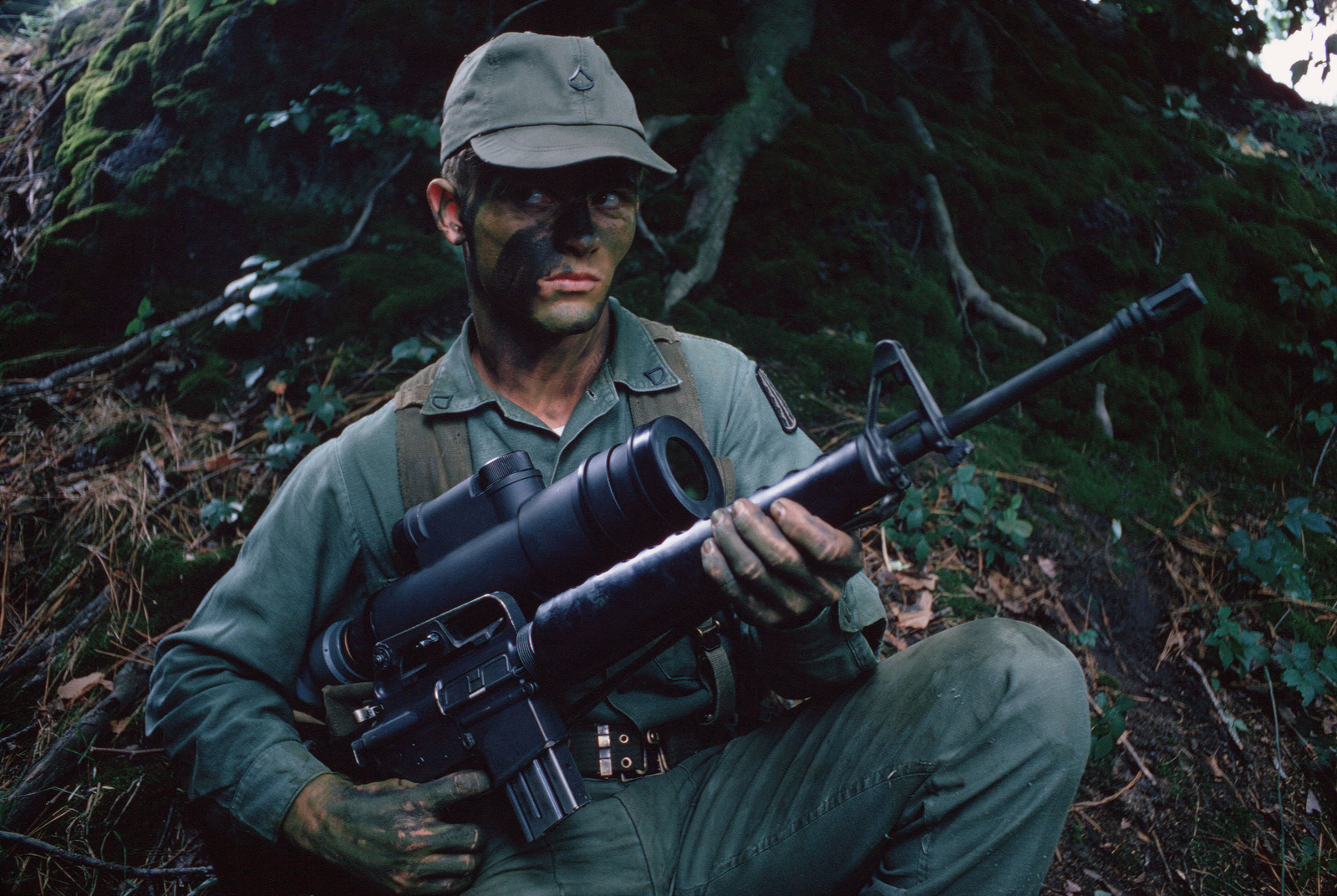 An infantryman armed with an M16A1 rifle and an AN/PVS-2 Starlight scope for use at night