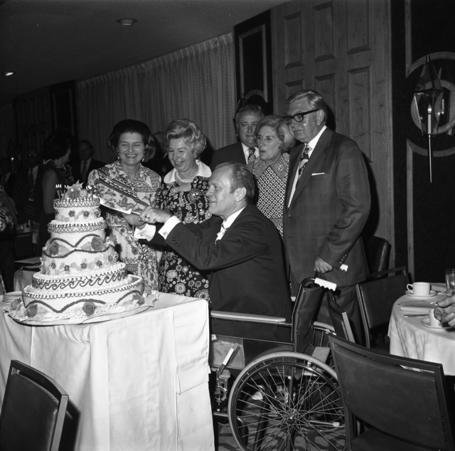 Photograph of Congressman Gerald R. Ford Cutting the Cake at His 59th Birthday Party