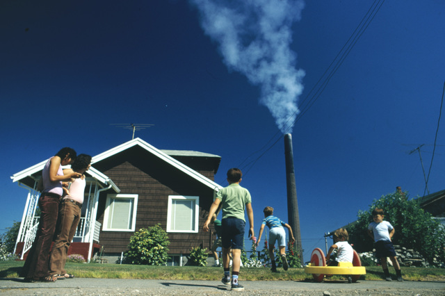 Children Play in Yard of Ruston Home, while Tacoma Smelter Stack Showers Area with Arsenic and Lead Residue