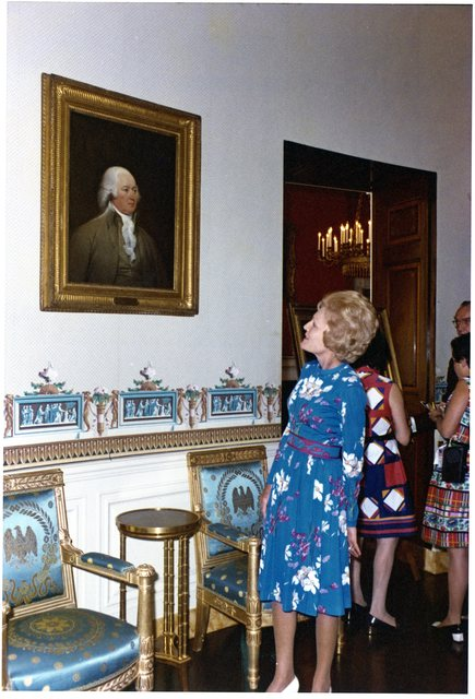Pat Nixon Standing by a Portrait of John Adams