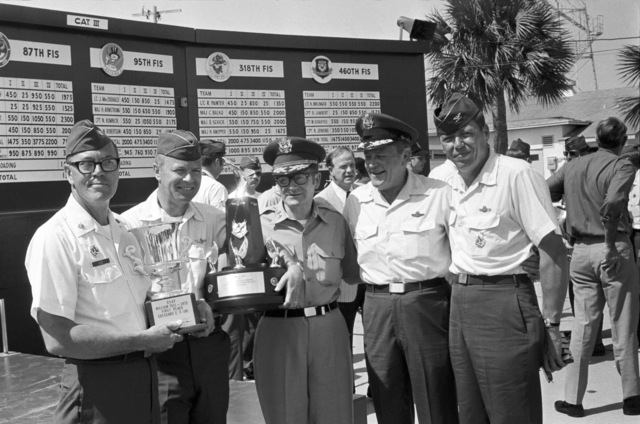 """U.S. Air Force personnel assigned to the 119th Fighter Wing""""Happy Hooligans"""", North Dakota Air National Guard, pose for a photo with winning trophies at the 1972""""William Tell""""Weapons Competition at Tyndall, Air Force Base, Fla. Left-to-right are MAJ. Alan Eide; LT. COL. Wally Hegg; MAJ. GEN. LaClair A. Melhouse, North Dakota Adjutant General; second from right not known; and COL. Alexander P. Macdonald. (A3604) (U.S. Air Force PHOTO) (Released)"""