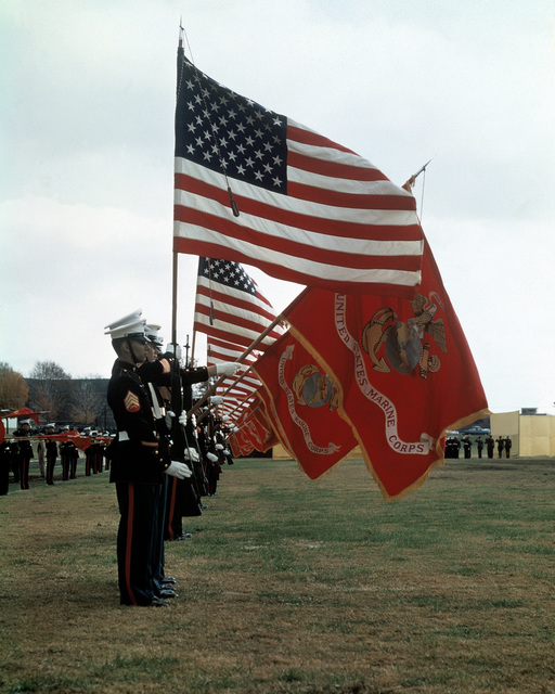 A side view of the colors being presented during a Marine Corps Birthday Pageant