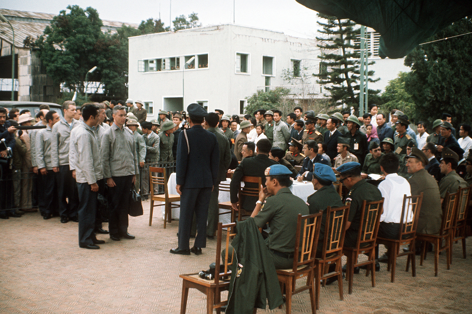 COL. Lynn is greeted by the Gia Lam Airport returnee delegation upon his release from a prisoner of war camp