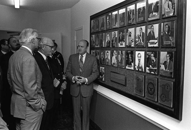Following the formal dedication of the Pentagon Correspondents Corridor, Secretary of Defense Melvin R. Laird, right, talks about American news correspondents who died covering military activities. Standing with him near the display of current Pentagon news correspondents are Secretary of the Air Force Robert C. Seamans Jr., Deputy Secretary of Defense Kenneth Rush, and Admiral Thomas H. Moorer, chairman, Joint Chiefs of Staff