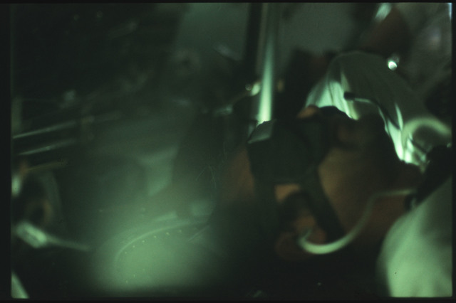 AS17-163-24116 - Apollo 17 - Apollo 17, Schmitt inside the Command Module