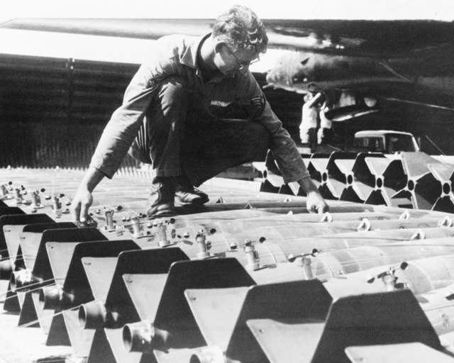 A munitions specialists prepares bombs as he helps support Strategic Air Command's flying mission during LINEBACKER Operations over North Vietnam