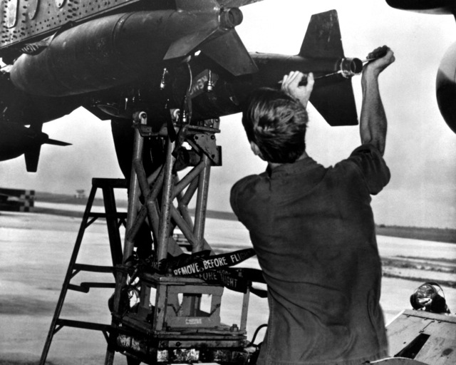 Bombs are loaded aboard a B-52 Stratofortress aircraft from Strategic Air Command as Arc Light, part of Operation Linebacker, gets underway
