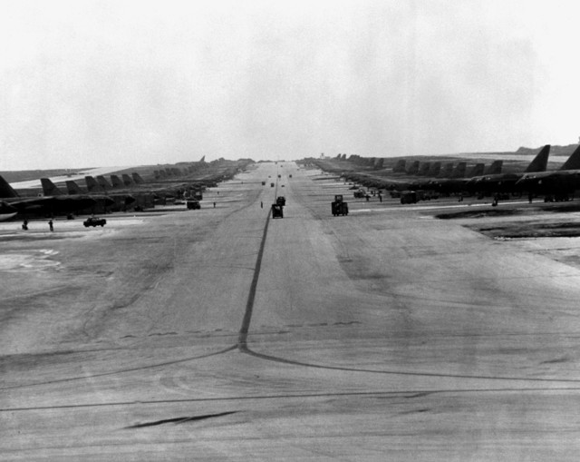 Maintenance and support vehicles are used to provide maintenance to parked B-52 Stratofortress aircraft, assigned to the Strategic Air Command (SAC), during Linebacker Operations over North Vietnam