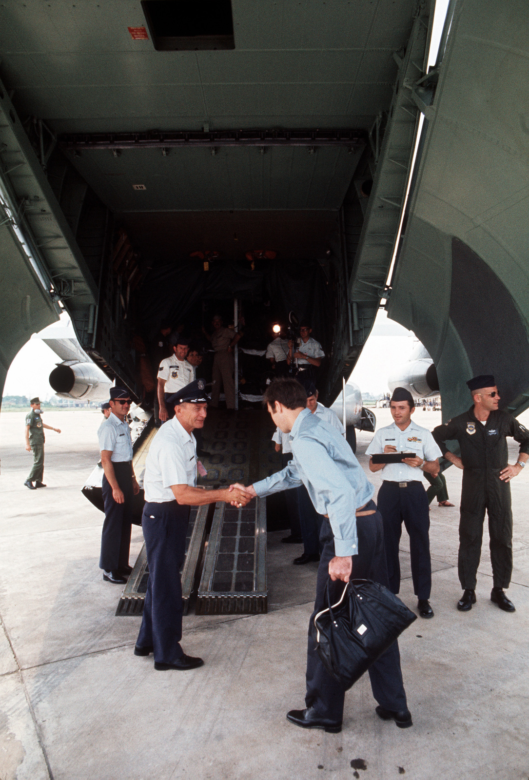 A C-141 Starlifter aircraft crew greets COL Jackolick, recently released prisoner of war. COL Jackolick will board the aircraft for evacuation to Clark Air Base, Republic of the Philippines