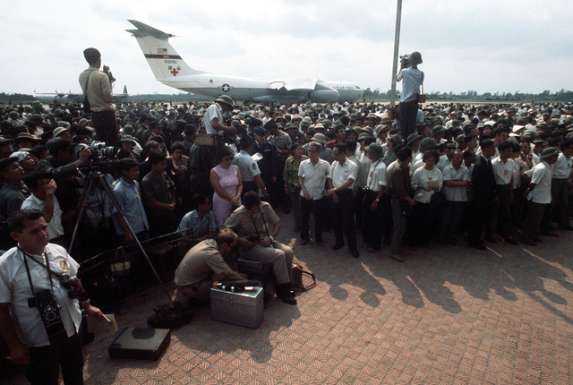 A crowd gathers to witness the release of prisoners of war at the Gia Lam Airport