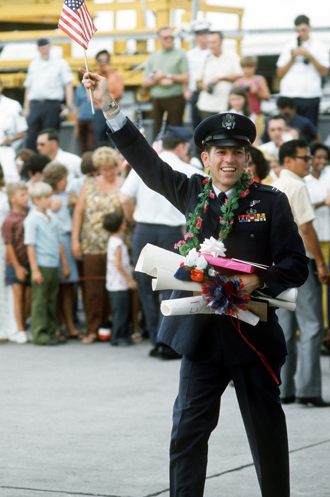 A recently released from a prisoner of war departs Clark Air Base en route to Travis Air Force Base, California