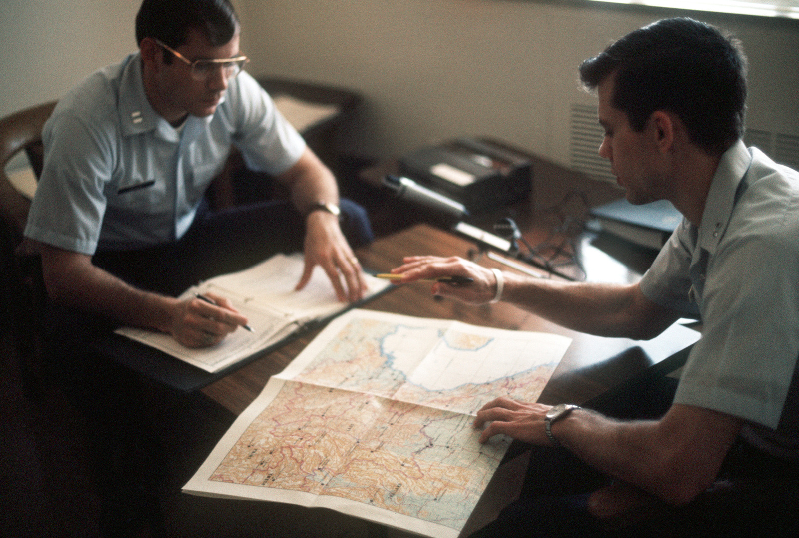 A returnee from a Vietnamese prisoner of war camp is debriefed upon his arrival at Travis Air Force Base
