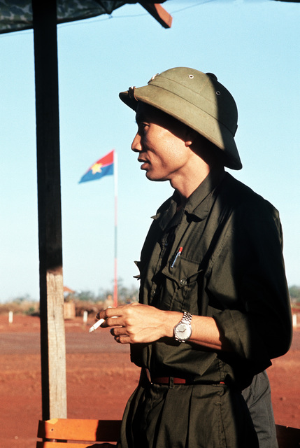 A Viet Cong officer smokes a cigarette