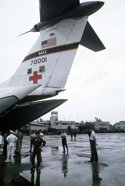 A view of the tail of a C-141 Starlifter aircraft from Military Airlift Command. The aircraft has just arrived at Gia Lam Airport to evacuate recently released prisoners of war to Clark Air Base, Republic of the Philippines