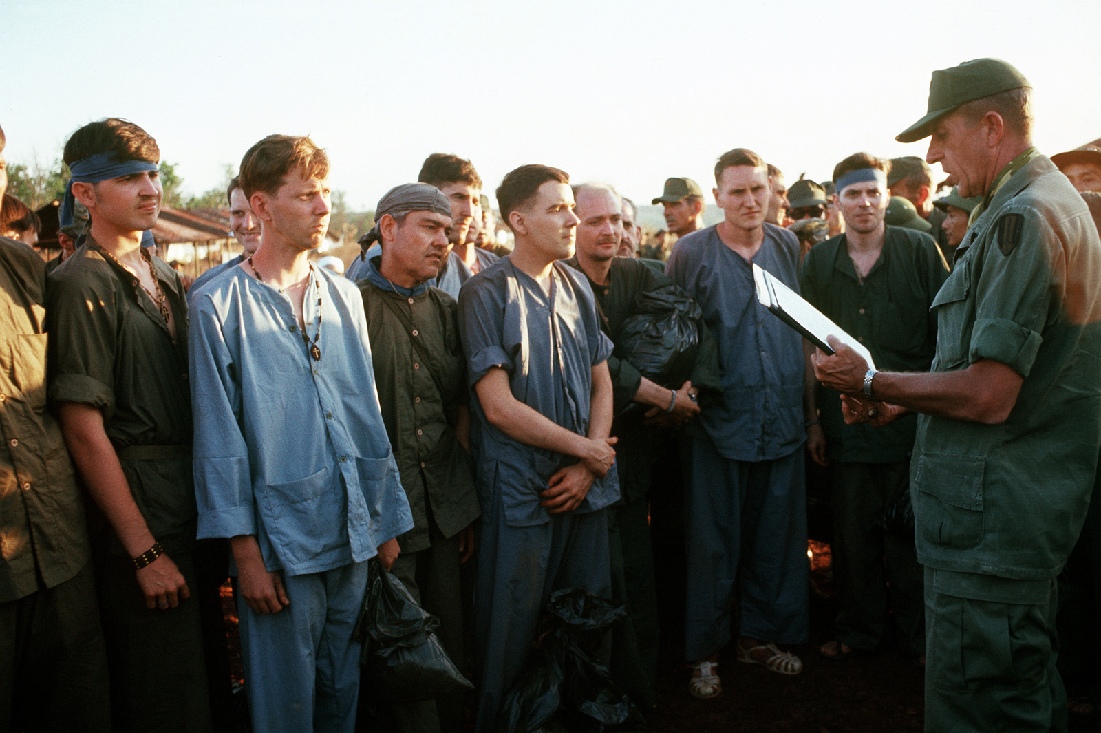 Americans are briefed prior to their release from a prisoner of war camp