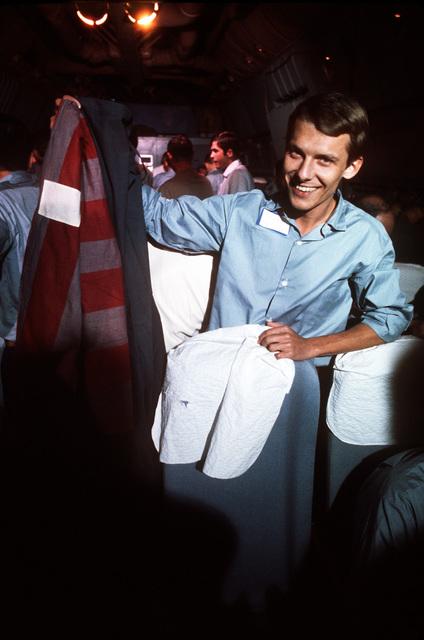Bernard Diehl, a German civilian, aboard a C-141 Starlifter aircraft after his recent release from a prisoner of war camp