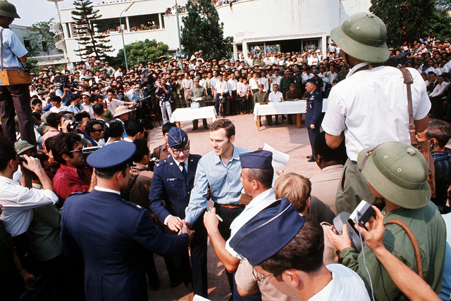 CAPT. James D. Kula is greeted by the Gia Lam Airport returnee delegation upon his release from a prisoner of war camp