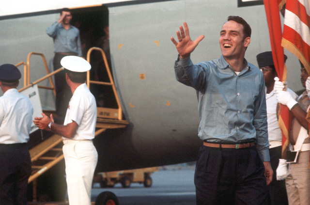 CAPT. Laurel Lingyel waves to the crowd gathered to welcome him to Clark Air Base upon his arrival aboard a C-141 Starlifter aircraft. CAPT. Lingyel was recently released from a prisoner of war camp in Vietnam