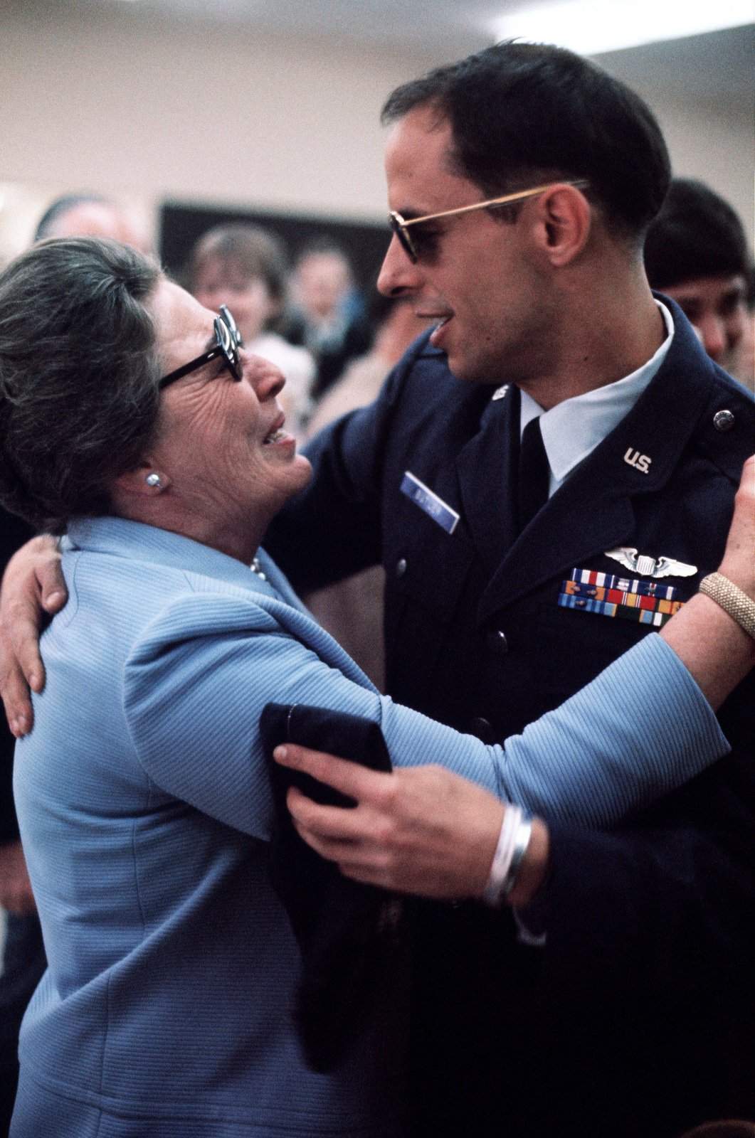Captain William W. Butler, a recently released prisoner of war, greets a member of his family upon his arrival at Travis Air Force Base