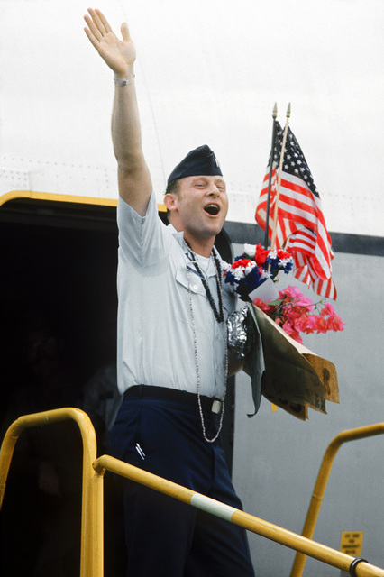 CPT James D. Cutter, recently released from a prisoner of war camp, departs Clark Air Base en route to Travis Air Force Base, California
