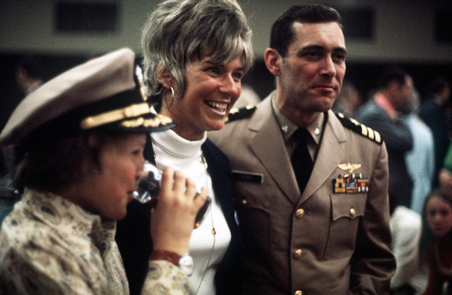 LT. CMDR. Edward d. Estes, a recently released prisoner of war, greets his family upon his arrival at Travis Air Force Base