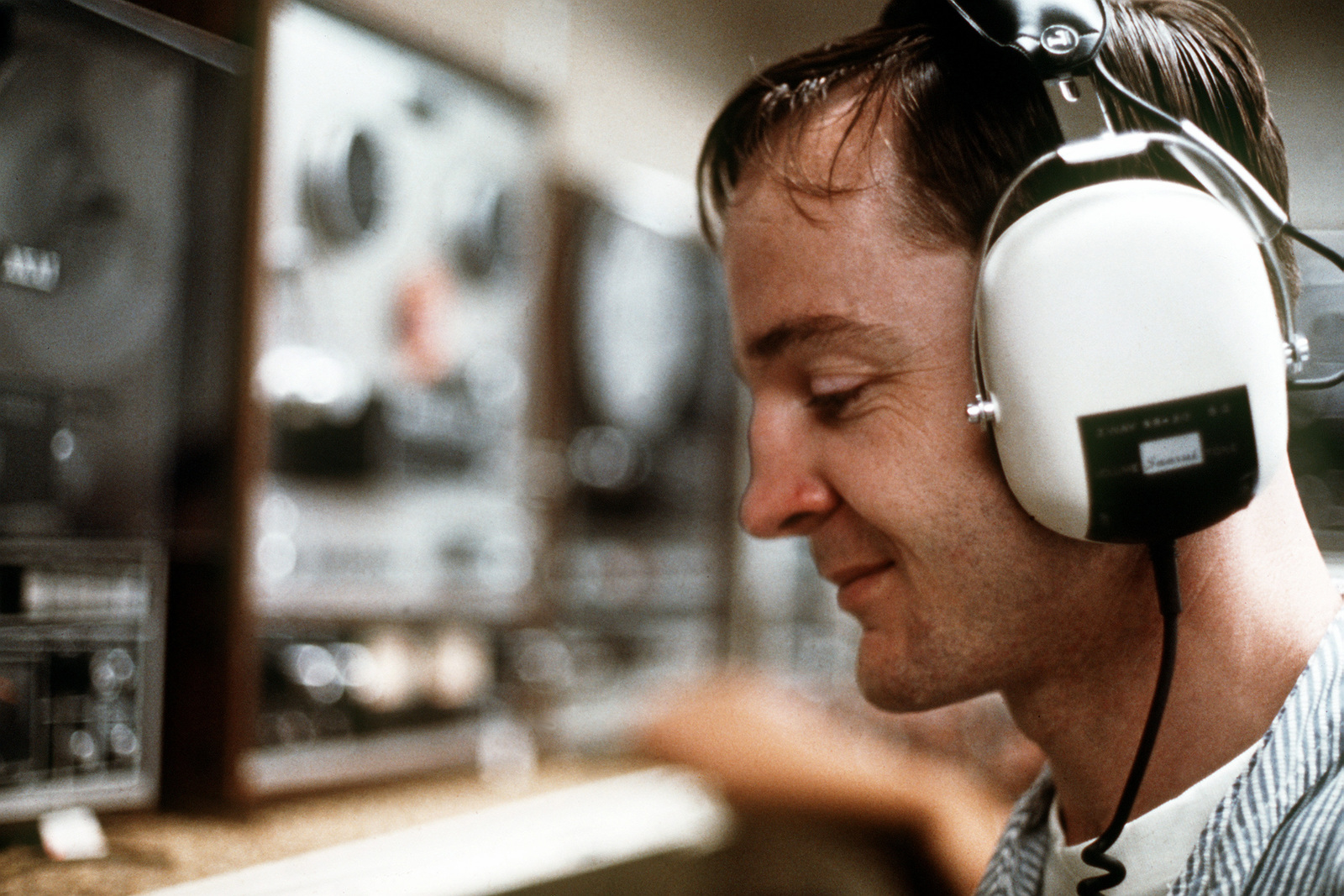 LT. CMDR. Michael Cronin listens to a stereo tape shortly after being released from a prisoner of war camp in Vietnam