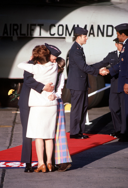 LT. COL. Alan L. Brunstrom, a recently released prisoner of war, greets his family upon his arrival at Travis Air Force Base