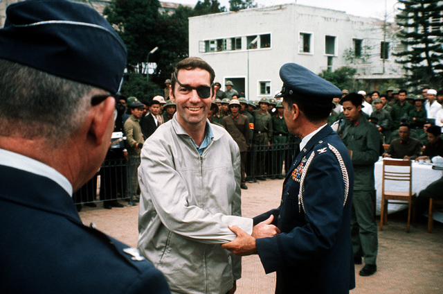 LT. COL. Lewis W. Shattuck is greeted by the Gia Lam Airport returnee delegation upon his release from a prisoner of war camp