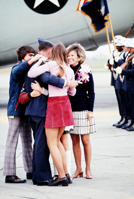 LT. COL. Robert L. Stirm, a recently released prisoner of war, greets his family upon his arrival at Travis Air Force Base