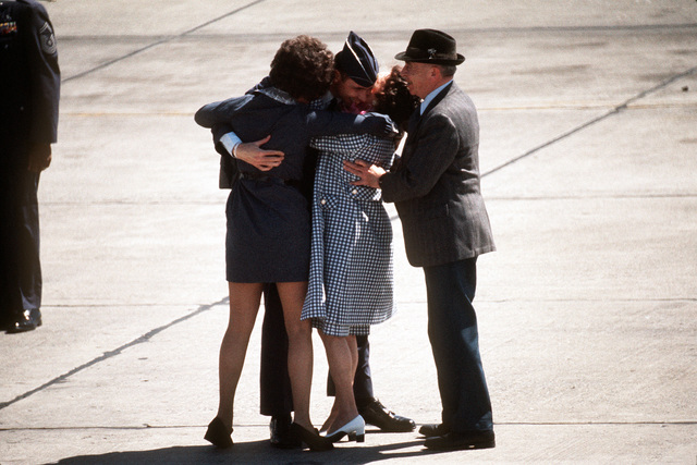 MAJ. Edward W. Leonard, a recently released prisoner of war, greets members of his family upon his arrival at Travis Air Force Base