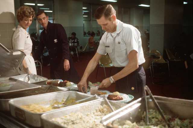 MAJ. Wesley Schierman, a recently released prisoner of war, goes through the cafeteria line upon his arrival at Travis Air Force Base