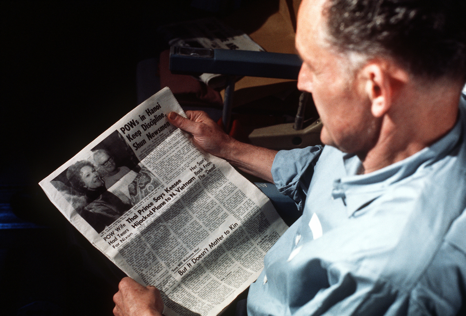 Phillip Manhard reads a Stars and Stripes newspaper after his recent release from a prisoner of war camp