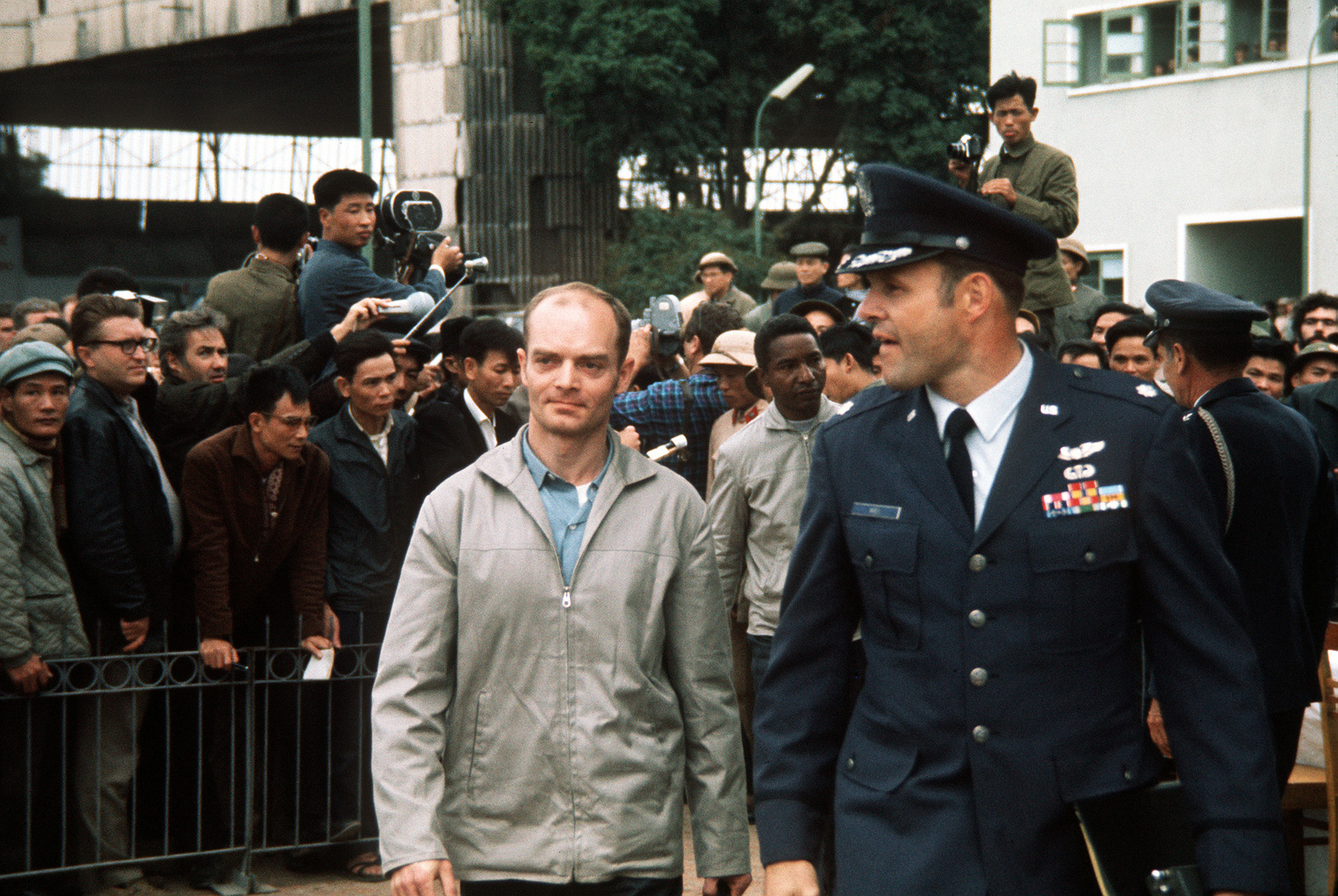 Recently released U.S. prisoner of war Knutson is greeted by the Gia Lam Airport returnee delegation