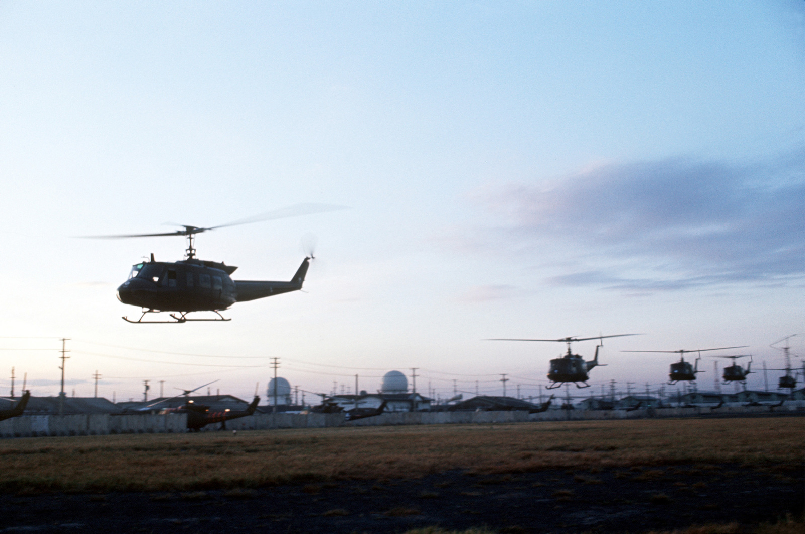 UH-1 Iroquois helicopters depart to pick up prisoners of war held at Loc Ninh
