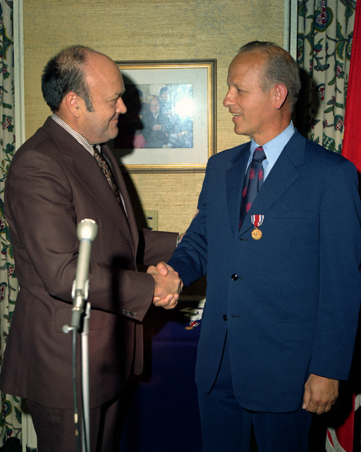 Secretary of Defense Melvin R. Laird, left, congratulates Secretary of the Army Robert F. Froehlke after presenting him with the Department of Defense Distinguished Public Service Medal during a Pentagon ceremony. Froehlke served as assistant secretary of defense for administration from January 30, 1969, until July 1, 1971, when he was appointed to his present position