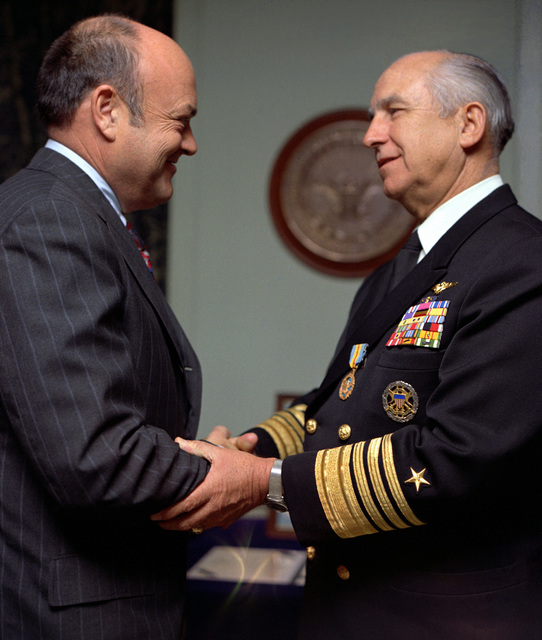 Secretary of Defense Melvin R. Laird, left, congratulates Adm. Thomas H. Moorer, chairman, Joint Chiefs of STAFF, after presenting him with the Department of Defense Distinguished Service Medal during a Pentagon ceremony. Moorer served as chief of naval operations from August 1, 1967, until July 1, 1970, and has held his current position since July 3, 1970