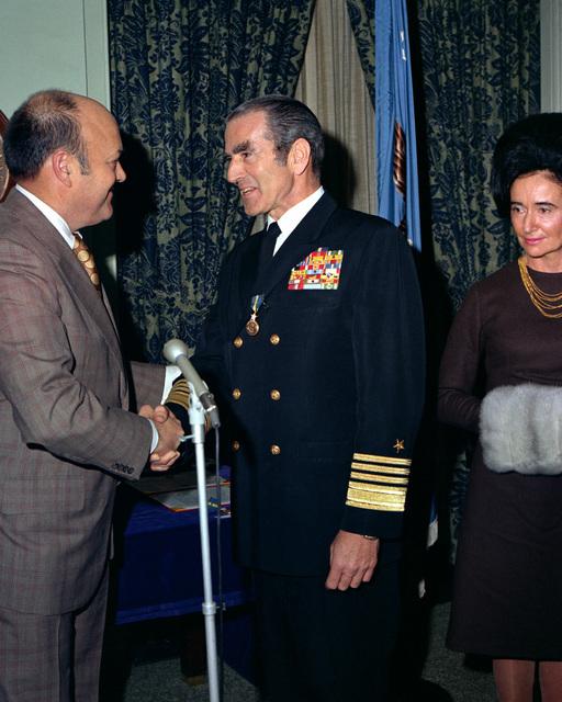Secretary of Defense Melvin R  Laird, left, congratulates